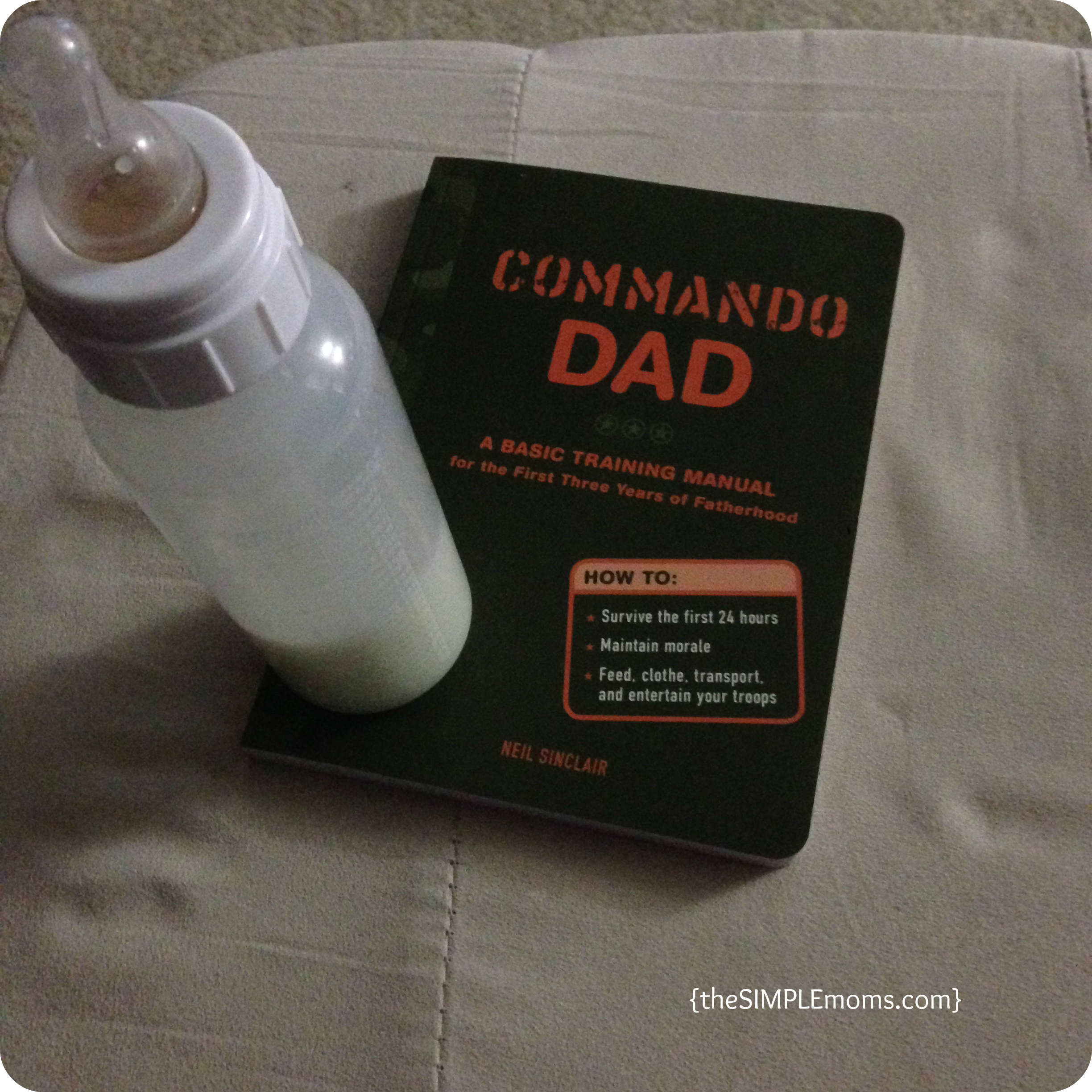 commando dad with baby bottle