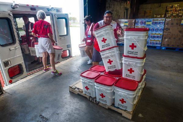September 2, 2017. Corpus Christi, Texas. Red Cross volunteer, Nolemi, of South Texas, loads cleanup kits into an Emergency Response Vehicle. Photo by Chuck Haupt/American Red Cross
